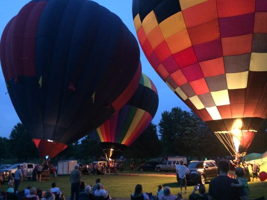 Hot-air balloons glow Thursday during 1st Bloom and Glow.