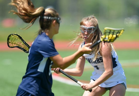 Pittsford's Ashley Sampone defends a Northport player during Friday's state Class A semifinal at SUNY Cortland.