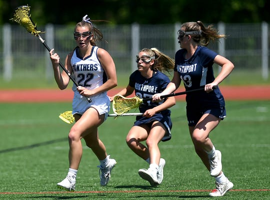 Pittsford's Abby Hopfinger (22) attempts to get past Northport opponents during the state Class A semifinals Friday at SUNY Cortland. Northport won 13-3.