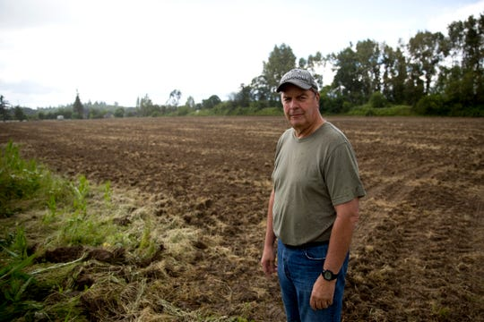 Property developer Gene Oster stands on the property he plans to build a 40-parcel subdivision on in Silverton on June 6, 2019.