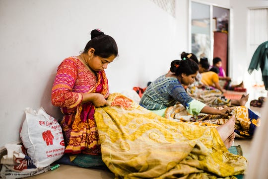 Bangladeshi women at Basha make kanthas to sell