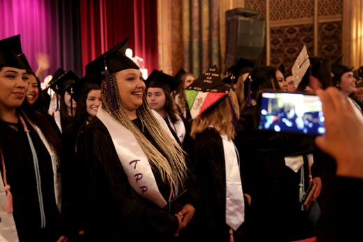 Early College High School student graduates with diploma and three associate degrees