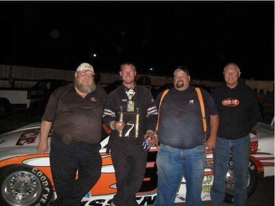 Bruce Latta (from left), Alan Cress, crew member Dave Cornelison and Stan Cress after a win at Douglas County Speedway in Roseburg.