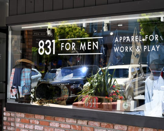 Apparel in the window of 831 For Men. June 7, 2019.