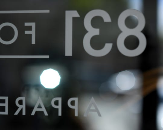 The 831 For Men logo in reverse, caught through the glass door. June 8, 2019.