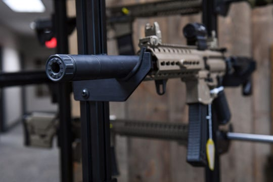 An example of a silencer sits on a display stand at Dakota Silencer on Friday, June 7, in Sioux Falls.