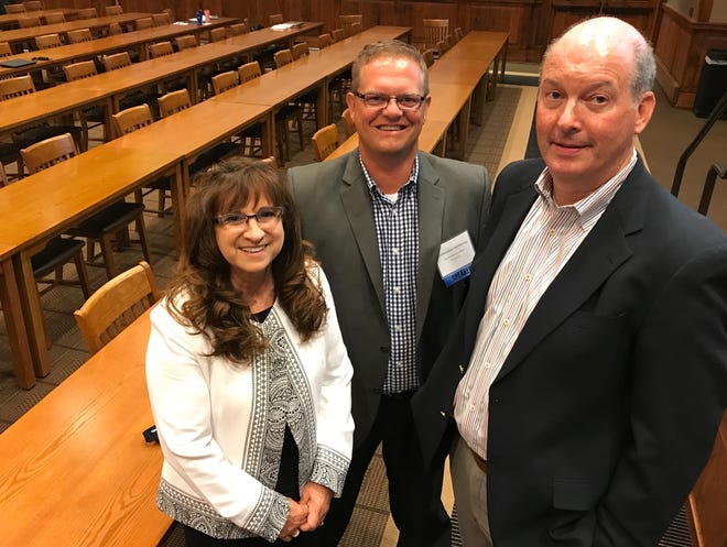 BJ Dvorak, president of eProvider Solutions, stands on left with H4 Technology CEO Chris Henkenius and Tony Tiefenthaler, H4T strategic account executive, in Sioux Falls on Wednesday, June 5.