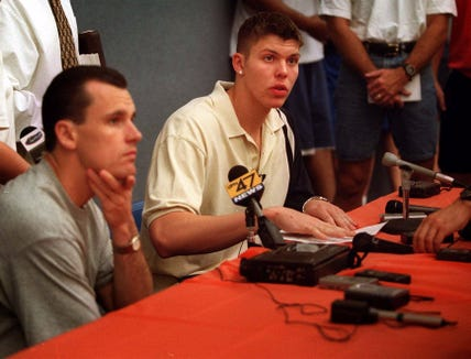 Mike Miller speaks at a news conference in Gainesville, Fla., in 2000 as coach Billy Donovan looks on. Miller announced that he was headed to the NBA.
