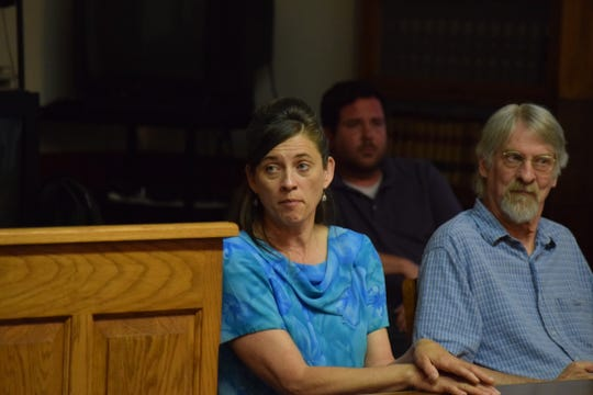 Cedar County Treasurer Peggy Kenney listens to speakers talk about issues with controlled agricultural feeding operations, or CAFOs, on Wednesday, June 5. In her own speech, Kenney defended local rules that restrict where the operations can locate.