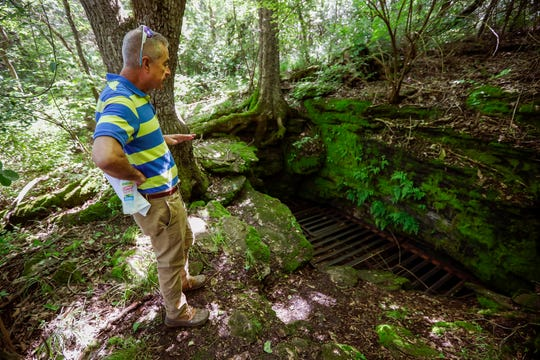 Dr. Gil Mobley stands near the entrance of a cave that he believes could be impacted by the project to extend Kansas Expressway in southwest Springfield.