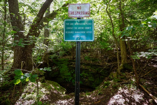 "A ""No Trespassing"" sign has been put up near the entrance of a cave that could be impacted by the project to extend Kansas Expressway."