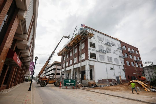 Crews work on the Hotel Vandivort's 42,000-square-foot expansion in downtown Springfield on Friday, June 7, 2019.
