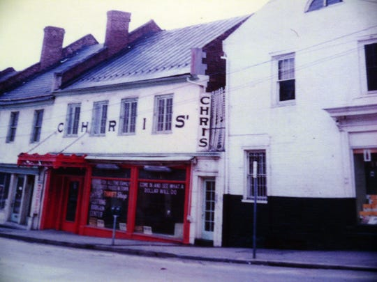 Chris' Restaurant on South New Street, in a 1950s or early '60s photograph. This pre-Civil War structure was knocked down for a parking lot as soon as the tenants left, destroying a vital piece of the historic downtown.