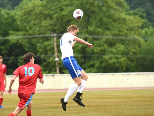 Lee High's Thomas Otteni heads a ball during Friday's VHSL Class 2 boys soccer state semifinal win over Giles.