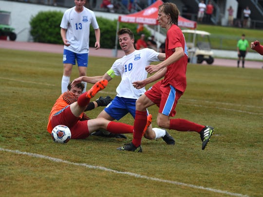 Lee High's Kyle Stenzel battles for the ball in front of the goal during Friday's VHSL Class 2 boys soccer state semifinal win over Giles.