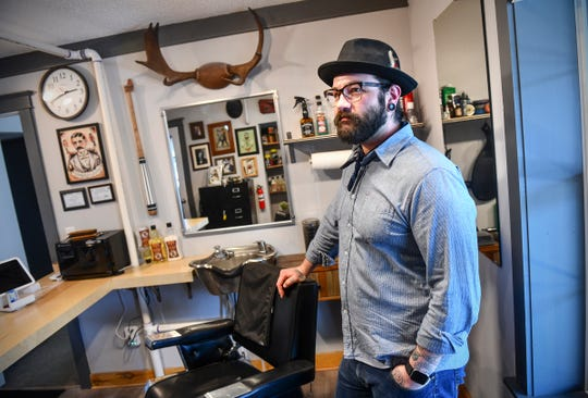 Brian Wohlman talks about his work at Two Bits Men's Grooming Salon Thursday, June 6, in St. Joseph.