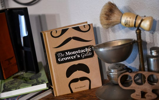 Many items are on display on the shelves at Two Bits Men's Grooming Salon Thursday, June 6, in St. Joseph.