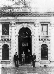 Florida Photographic Collection George Saxon, left, stands outside the original offices of the Capital City Bank on South Monroe Street, between Park Avenue and College Avenue.