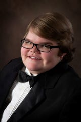 Henry Johnson, 18, took his graduation pictures on April 12, about a month before his passing.
