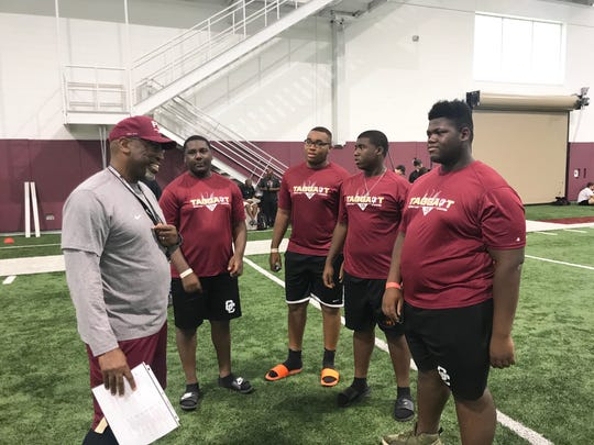 FSU defensive coordinator/defensive back coach Harlon Barnett talks with Gadsden County players Demetrius Lawson (left), Jordan White, Jamal Stanley and Jatavius Richardson at the Willie Taggart Big Man Camp on Friday, June 7, 2019.