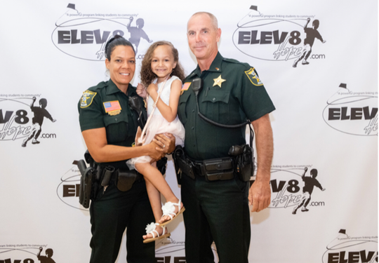 Officer Crystal Duncombe, left, Shania and Lt. Danny Cunningham at Elev8Hope's Stories of Hope dinner at the Kane Center.