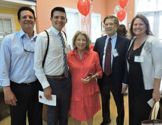 Nina Haven Scholarship recipient Hunter Enos, second from left, with father Troy Enos, Nina Haven Board of Directors President Judy Weber, Tom Weber and mother Stephanie Enos at the Nina Haven Circle of Scholars Reception.
