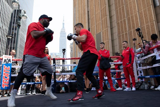 Gennady Golovkin, center, of Kazakhstan, boxes with his trainer Johnathon Banks, left, at a workout outside Madison Square Garden on Tuesday, June 4, 2019, in New York. He faces Steve Rolls, of Canada, in a middleweight bout on Saturday, June 8, 2019.