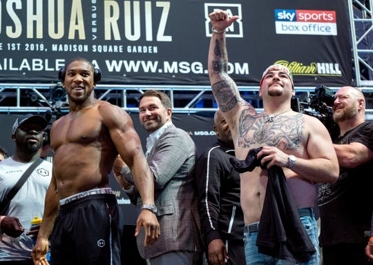 Heavyweight boxers Anthony Joshua, left, and Andy Ruiz Jr. acknowledge fans during a weigh-in at Madison Square Garden on Friday, May 31, 2019, before their title bout Saturday, June 1, 2019, in New York. Ruiz won the bout.
