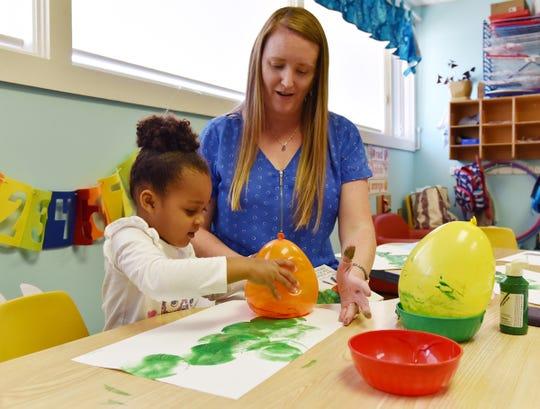Children work on art activities at Disciples Child Development Center.