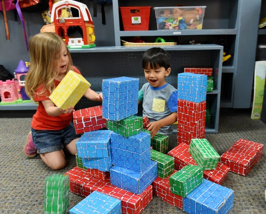 Children play with blocks at St. James Day School.