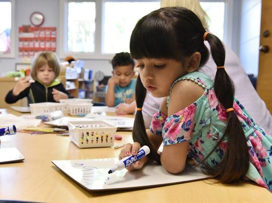 Children work on writing exercises at Disciples Child Development Center.