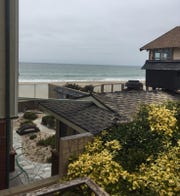 The view from the second floor of the home owned by Juli Scott and Scott Howard. The fence has come down in the distance because of pressure from the sand.