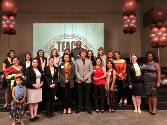 TEACh college scholarship winners pose with well-wishers at a banquet in their honor on Tuesday. The awards go to college students who were in foster care as children.