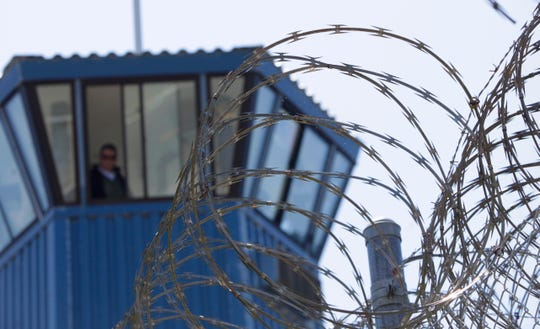 In this Aug. 17, 2011, file photo, concertina wire and a guard tower are seen at Pelican Bay State Prison near Crescent City.