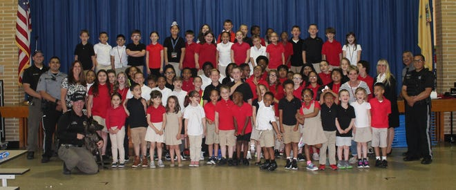 """Fifth-graders from Winslow School were declared the winners of the Cumberland County Freeholders' """"Pennies for Boomer"""" contest."""