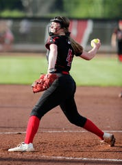 Tri-County's Erica Pronschinske (4) winds up a pitch to Belmont on Thursday in Madison.