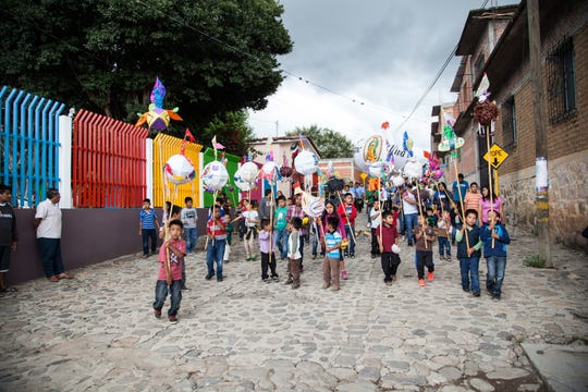 Children celebrating in Oaxaca, Mexico.
