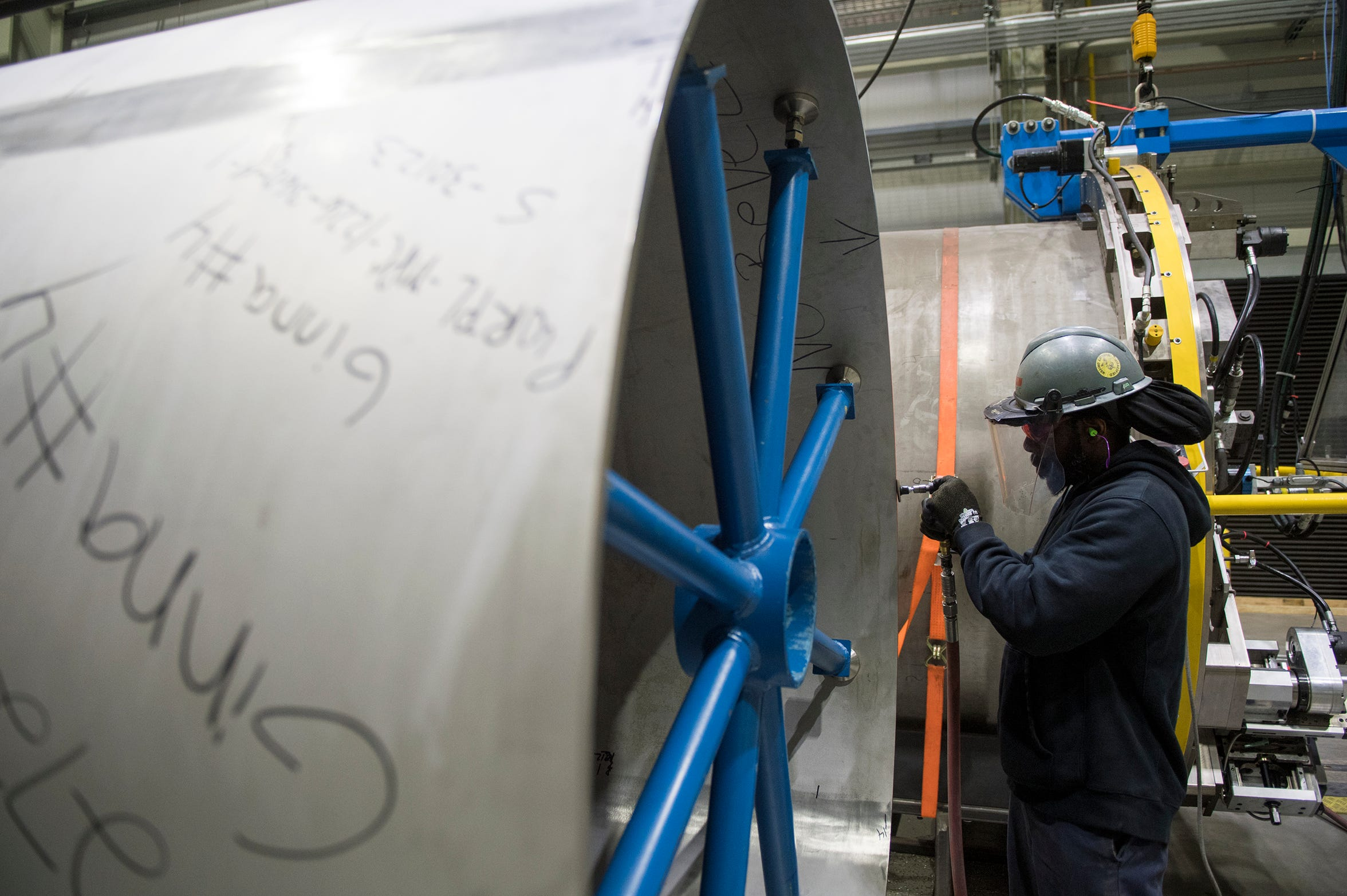 Welder Carlos Haynes smoothes the surface of a canister inside Holtec International in Camden, N.J. Friday, May 10, 2019.