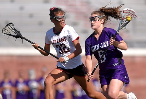 John Jay's Cara O'Reilly (6) looks to get past J-D's Arysa Lux (32) during the first half of John Jay vs. Jamesville-DeWitt, 2019 NYSPHSAA Girls Lacrosse Championship, Class C Semi-final, SUNY Cortland, Friday, June 7, 2019.