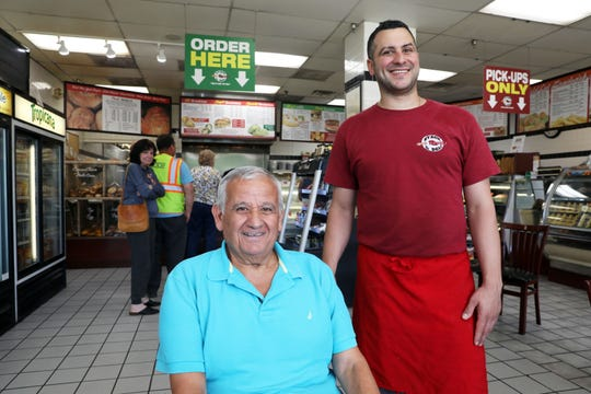Billy Kamvosoulis, 69, and his son Chris Kamvosoulis, 36, of Nyack Hot Bagels & Deli June 6, 2019. Chris started helping his dad out here and there in his teens and has stayed in the family business since.