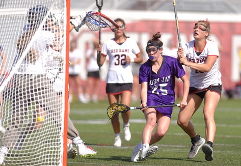 John Jay's Charlotte Wilmoth (25) shown here in a semifinal win over Jamesville-DeWitt, scored four more goals in the NYSPHSAA Class C  championship game on June 8, 2019 at SUNY Cortland, but the Indians came up short against Shoreham Wading River.