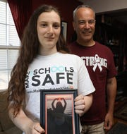 Jordan Turner and his daughter, Jadyn Turner Turner of Nyack support Alyssa's Law for Alyssa Alhadeff one of the 17 victims of the Parkland shooting at Marjory Stoneman Douglas High school at their home in Nyack June 4, 2019. ÒAlyssaÕs LawÓ is designed to yield quicker response times from law enforcement in the case of a school emergency, by sending them a signal or message when the alarm is activated.