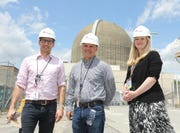 Reporters Christopher Maag, Tom Zambito and Amanda Oglesby stand next to the nuclear fuel dry cask storage facility at Indian Point Energy Center in Buchanan on Monday, May 20, 2019.