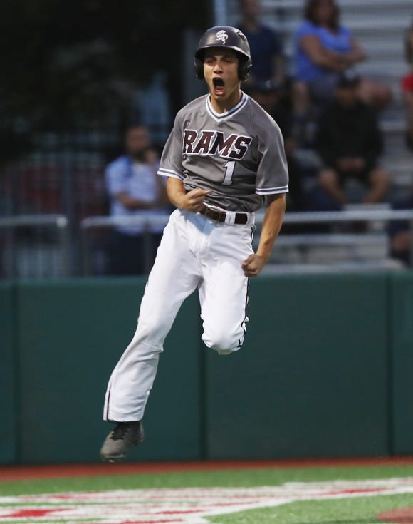 Fordham's Jack Andreana celebrates as he scores in the 5th inning against Stepinac in the CHSAA Class AA City Championship at St. John's University in Queens June 6,  2019. Fordham won the game 4-0.