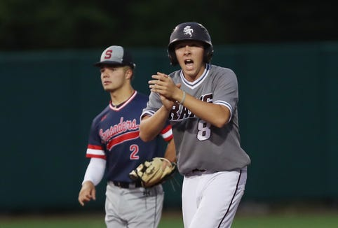 Fordham's Nick Valdes (8) cheers on his teammates from second base during game against Stepinac in the CHSAA Class AA City Championship at St. John's University in Queens June 6,  2019. Fordham won the game 4-0.