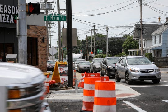 Cars inch through downtown Newark on Friday, June 7, 2019. Traffic is narrowed to a single lane due to a year-long construction project to repave and improve the street.