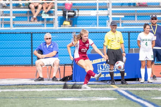 Caravel's Nicole Rankin kicks the ball in the  Buccaneers win over Tower Hill in the championship game of the DIAA Division II Girls Soccer Tournament on Saturday, June 1, 2019.