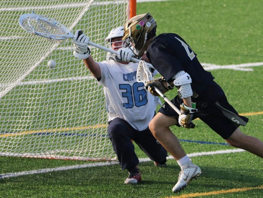 Cape Henlopen goalie Baxter Travers stops Salesianum's Christopher Wong from point-blank range in the third quarter of the Vikings' 12-10 win in the DIAA Boys Lacrosse Tournament championship game at Caesar Rodney High School on Thursday.