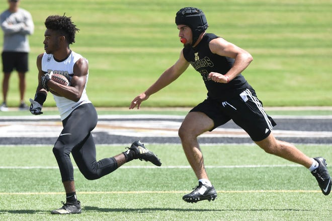 Rider's Nick Darcus looks for room to run against Abilene High in Friday's 7-on-7 state qualifying tournament in Abilene.