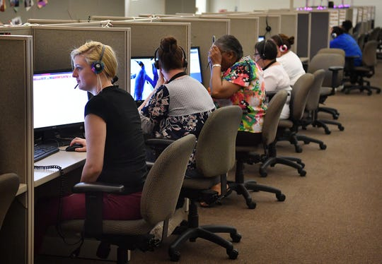 Customer service call-takers working at The Results Companies call center Friday morning. The business formerly known as USA800 is under new ownership and has rebranded as The Results Companies with 22 call centers nationally.